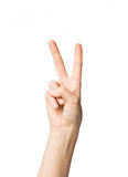 Close up of hand showing peace or victory sign Royalty Free Stock Photo