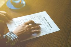 Close up hand sign vendor contract on table for the new house, concept stock images