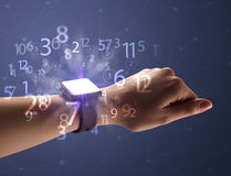 Close up hand with smartwatch and numbers Stock Photos