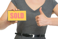 Close up on hand with sold sign and hand showing t Stock Photography