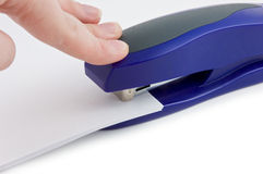 Close up of hand stapling bills. Stock Photography