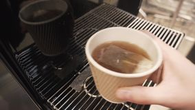 Close-up of a hand taking a disposable cardboard cup of tea. Close-up of a hand taking a disposable cardboard cup of tea, 4k stock video footage