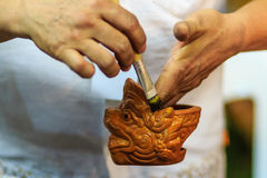 Close up hand of Thai sculptor during painting the masterpiece o Stock Photography