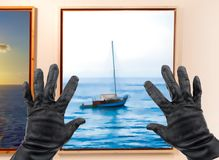 Stealing a painting stock photo