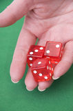 Close up of a hand throwing dices Stock Photo