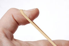 Close up of hand / thumb pulling rubberband taut Royalty Free Stock Image
