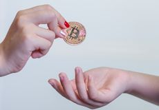 Crypto Currency Coin Flip. Close up of a hand about to flip a Litecoin coin Stock Photos