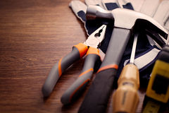 Close up Hand Tools on the Wooden Table Royalty Free Stock Photo