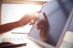 Close Up Hand Touching Laptop Screen With Lens Flare Royalty Free Stock Photo