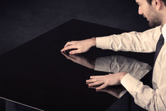 Close up of a hand touching smart table with copy space Stock Photos