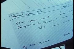 Close-up of hand turning pages of expense book stock video footage