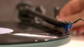 Close up hand turning on vintage record player.