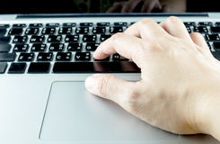 Close up hand type on laptop keyboard, Technology concept.  Stock Photography