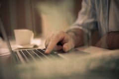 Close-up hand typing keyboard computer. royalty free stock images