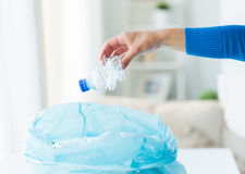 Close up of hand and used bottles in rubbish bag Royalty Free Stock Image