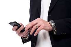 Close up of hand using cell phone. Cropped image of male hand operating mobile phone Royalty Free Stock Images