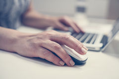 Close up of hand using laptop. Stock Photo