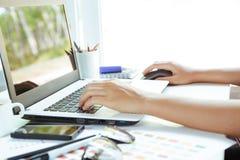 Close up hand using laptop on desk Stock Photos