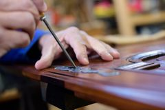 Close up hand using screw driver for restoring Royalty Free Stock Image