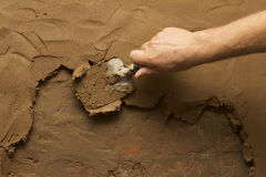 Close-up of hand using trowel to finish wet concrete floor Royalty Free Stock Photo
