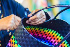 Close up hand of weaver during weaving basket made from plastic Royalty Free Stock Image