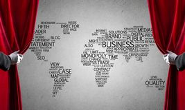 World map behind drapery curtain and hand opening it. Close up of hand in white glove open red velvet curtain stock image