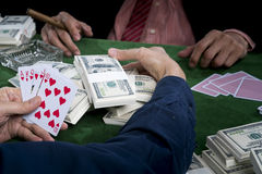 Close up at the hand of winner player gather the bets and show t stock photo