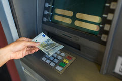 Close up of hand withdrawing money at atm machine Royalty Free Stock Images