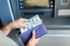 Close up of hand withdrawing money at atm machine Stock Photos