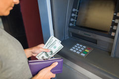Close up of hand withdrawing money at atm machine Stock Images