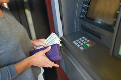 Close up of hand withdrawing money at atm machine Stock Photo