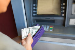 Close up of hand withdrawing money at atm machine Royalty Free Stock Photo