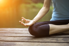 Close up hand. Woman do yoda outdoor. Woman exercising yoga at the nature background. Select focus Royalty Free Stock Photos