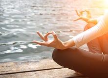 Close up hand. Woman do yoda outdoor. Woman exercising yoga Stock Image