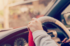 Close up hand woman driving car Stock Images