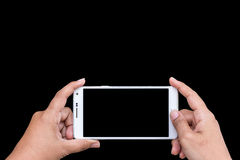 Close up hand of woman holding smartphone isolated on black. Sav Stock Photography