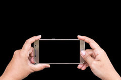 Close up hand of woman holding smartphone isolated on black. Sav Royalty Free Stock Photos