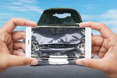 Close up hand of woman holding smartphone and take photo of car accident stock photos