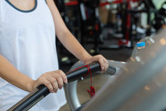 Close-up hand woman jogging and running on treadmill cardio Royalty Free Stock Photography