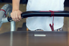 Close-up hand woman jogging and running on treadmill cardio Royalty Free Stock Photo