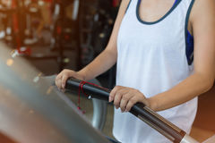 Close-up hand woman jogging and running on treadmill cardio Royalty Free Stock Image