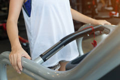 Close-up hand woman jogging and running on treadmill cardio Stock Photos