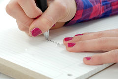 Close up of hand of woman taking notes Stock Images
