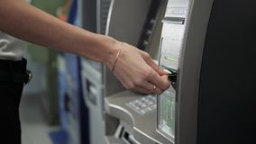 Close up of hand of a woman using banking machine, atm withdrawal with credit card business, dollar euro. Close up of hand of a man using banking machine stock video footage