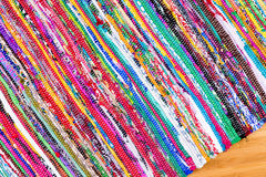 Close up on hand woven colorful rug at angle Stock Photos