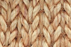 Hand Woven / Tied Rug Detail. Close up of Hand Woven / Tied Rug Detail, Patterned Sisal, Hemp Background Texture royalty free stock photo
