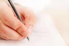 Close up with a hand writing Royalty Free Stock Image