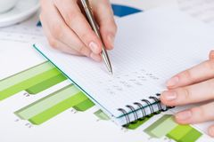 Close up of hand writing in the notebook Royalty Free Stock Photography