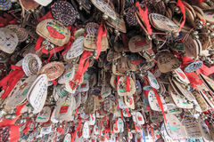 Close up of hand written prayers hanging on a roof. Royalty Free Stock Photography