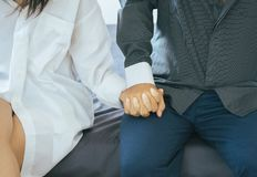 Close up of hands young couples holding together in lovely and romantic moment,Valentines day concept,First date. Close up of hand young couples holding together stock photo